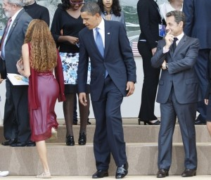 US President Obama and France's President Sarkozy take their places with junior G8 delegates for a family photo at the G8 summit in L'Aquila